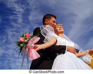 harmony - fiance and bride on blue sky
