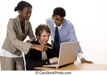 Technology Team - Three people working on a silver laptop...