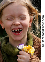 Spring girl  - Little laughing girl with a bunch of crocuses