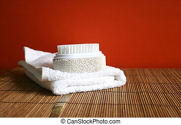 Pumice brush and towel at a spa - health and beauty