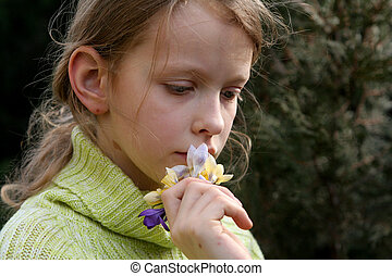 Spring mood - Young thoughtful girl with a bunch of crocuses