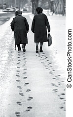 Old age - Old women and footpath on the snow