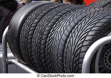 racing tire - tire of a racing car in the shelf