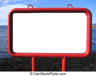 Blank billboard with red frame standing by the sea