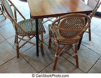 Café with tables and chairs in an indoor shot
