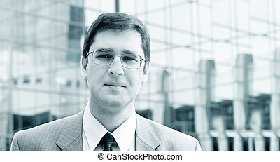 Businessman in blue - Serious businessman in front of the...