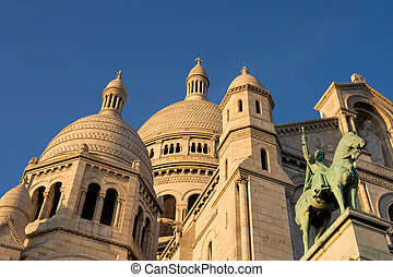 The Sacre Coeur at dusk - Low-angle view of the Sacre Coeur...