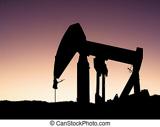 Pumpjack Silhouette - An old pumpjack silhouetted against...