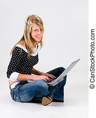 Girl with laptop in studio Withe background