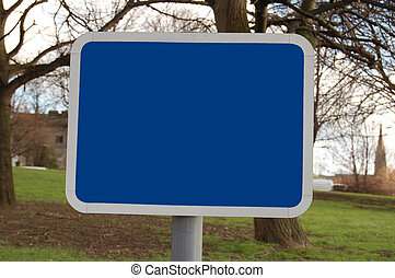 Blank Sign - Blue sign with tree and grass background on a...