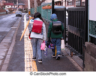 Schoolchildren walking tiredness to their home