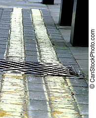 Double Yellow lines - Close up of double yellow lines and a...