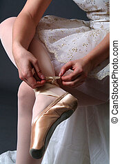 Getting Ready - Ballerina adjusting shoes