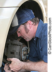 Skilled Auto Mechanic - A closeup of an auto mechanic...