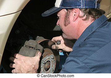 Auto Mechanic At Work