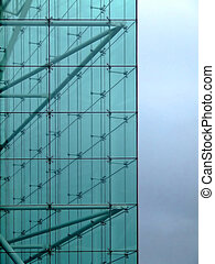 Glass wall - Detail of a glass building with a sky in...