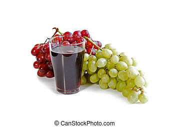Grapes and juice - Red and green grapes with a glass of...