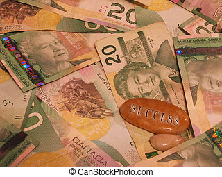 Canadian Money - Canadian twenty dollar bills with a success...