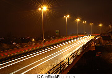 Night Driving - Traffic on a dual carriageway at night with...