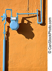 The Blue Meter - Blue gas meter against a terracotta wall