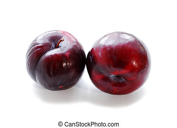Plums - Two purple plums on white background