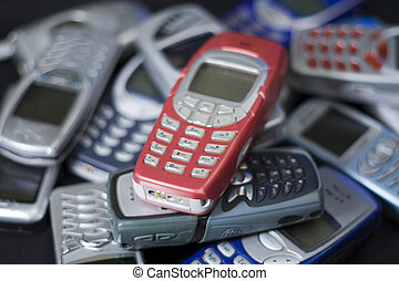 Cell phones in red - Red Nokia style mobile telephone in...