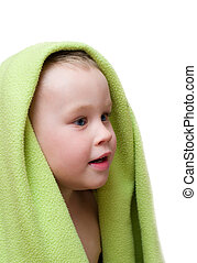 Small boy in green towel