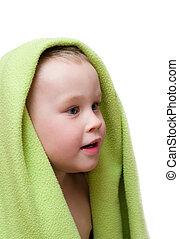 Small boy in green towel