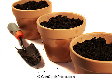 Terra Cotta Pots - a garden trowel and terracotta pots