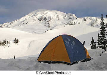 Tent and Rainier - A single tent is pitched high on Mt....
