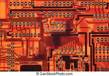Red Circuitboard - Close-up of red circuitboard and copper...