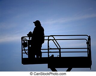 silhouette of director on scaffold with megaphone