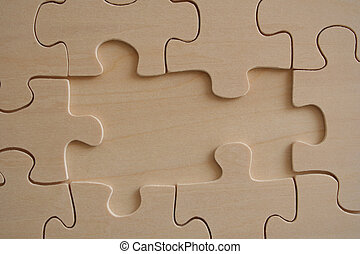 Wooden jigsaw 3 - Wooden jigsaw background with two missed...