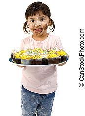 Toddler and Cupcakes - Adorable two year old girl covered in...