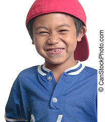 Cute happy boy in red baseball cap close up on white