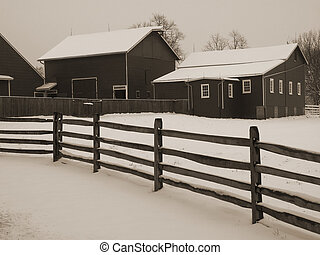 Snowy Barnyard - This is a light sepia toned image of a...