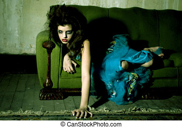 Goth Girl - Young girl in goth on old couch.