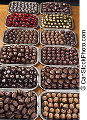 Mega Chocolate - A table lined with silver platters of...
