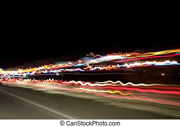 Night Lights on the Highway - Shot of the highway and car...