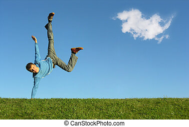 man on hand on blue sky with cloud