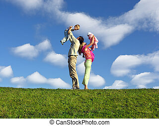 family with two children under clouds