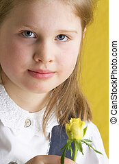 charming girl - young girl with yellow flower