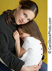 safety - mother holding her cute daughter