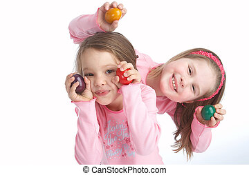 eastereggs - two sisters playing with eastereggs