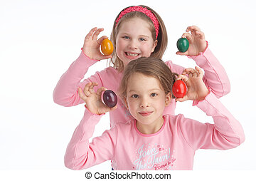 eggs - two sisters playing with eastereggs