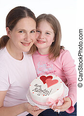 mother and daughter with mothersday tart