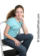 Relaxed Teen In T-shirt - A stylish school girl wearing a...