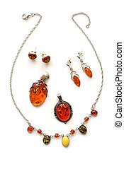 Amber jewelry on white background
