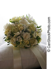 Wedding bouquet sitting on a pillow