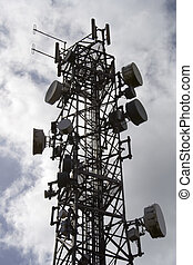 Telecommunications mast 3 - Silhouetted mobile cell phone...